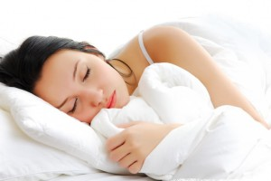 Beautiful woman lying and sleep on the snowy bed